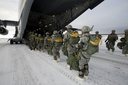 ELMENDORF AIR FORCE BASE, Alaska -- Air Force Tactical Air Control Party members and Airborne Soldiers from the 4th Quartermasters, Fort Richardson, Alaska, board a C-17 Globemaster III from the 517th Airlift Squadron before a training mission. The traini